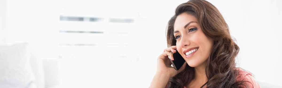 a lady smiling while on the phone